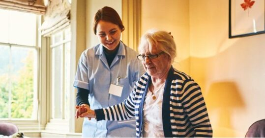 A nurse with a care home resident.