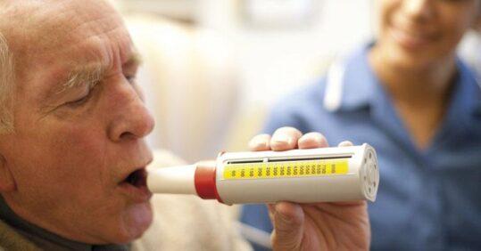 Man taking lung function test.