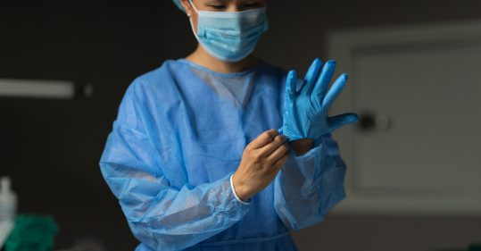 A healthcare worker in PPE.