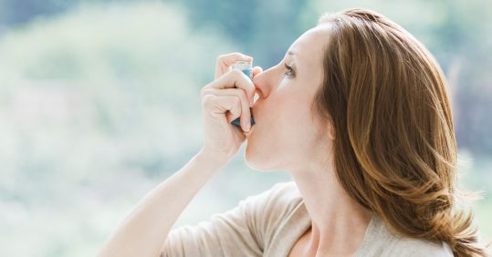 Asthma patient taking inhaler