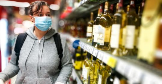 Woman purchasing alcohol during the Covid-19 pandemic.