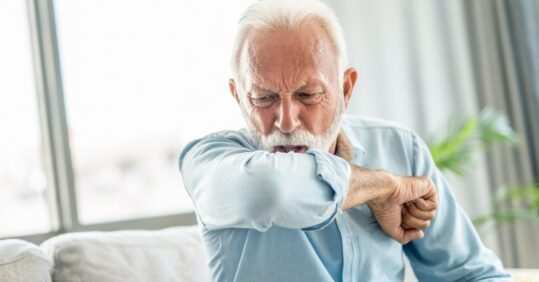 older man coughing